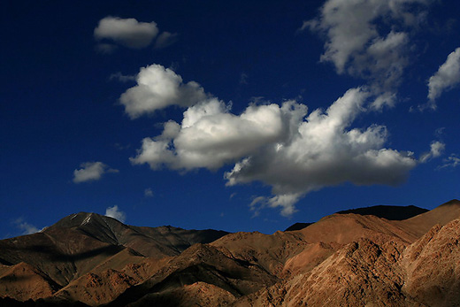 Puffy Clouds over Ladakh Range of Mountains