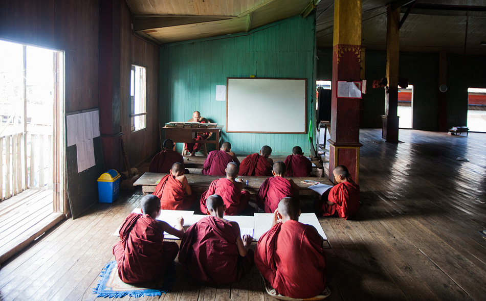 Young monks being tutored at Ywama Monastery, Inle Lake Region, Myanmar.