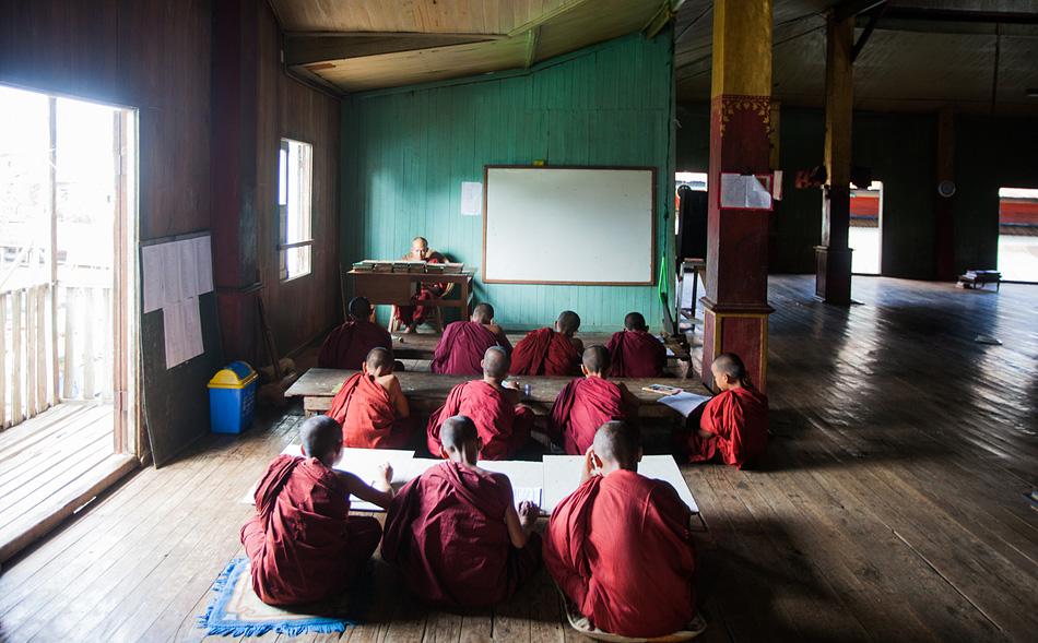 Young monks being tutored at Ywama Monastery, Inle Lake Region, Myanmar.