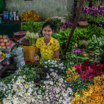 A girl selling flowers at Bago Market